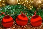 Christmas balls with green fir-tree branch — Stockfoto