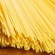 Bunch of spaghetti on wooden brown background — Stock Photo #59496899