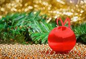 Christmas ball with yellow tinsel — Stock Photo