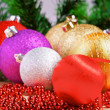 Variety of christmas balls on red beads decoration — Stock Photo #59563327