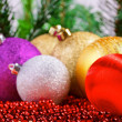 Variety of christmas balls on red beads decoration — Stock Photo #59563621