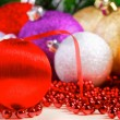 Variety of christmas balls on red beads decoration — Stock Photo #59563863