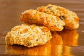 Tasty crunchy and crumbling cookies on yellow glossy paper — Stock Photo