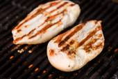 Grilled chicken breast fillets on BBQ — Stock Photo