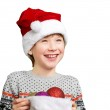 Portrait of a boy in christmas hat holdink white blank. Isolated — Stock Photo #78888224