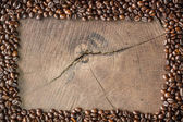 Frame of coffee beans on stump background — Stock Photo
