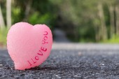 Love symbol on asphalt road — Stock Photo
