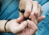 Closeup at the hands of Caucasian man rolling a Marijuana joint — Stock Photo