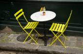 Terrace with metalic yellow chairs — Stock Photo