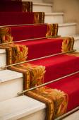 Red carper in palace hotel — Stock Photo