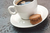 Cup of coffe with french chocolate macaron — Foto de Stock