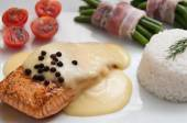 Salmon steak with hollanders sauce and rice  and Green beans in roll bacon — Foto de Stock