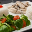 Chicken with mushrooms and rice with salad and cherry tomatoes — Stock Photo #59073085