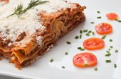 Lasagna with cherry tomatoes presentation in a plate — Zdjęcie stockowe
