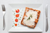 Lasagna with cherry tomatoes presentation in a plate — Stock Photo