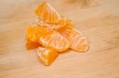 Piece of tangerine on wooden background — Stok fotoğraf