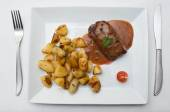 Steak grilled with pepper sauce and potatoes — Stock Photo