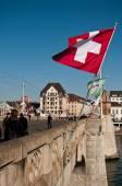 BASEL - Switzerland - 11 February 2015 - Mittlere Brücke Bridge with Switzerland flag — Stock Photo