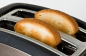 Toaster with bread slices — Stock Photo