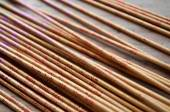 Asian incense closeup on wooden background — Stock Photo