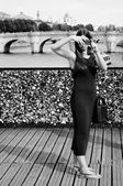 PARIS - France -     10 august 2013 - Woman take a picture in bridge of Arts in Paris — Stock Photo