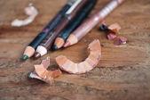 Makeup pencil closeup on wooden background — Stock Photo