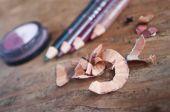 Makeup pencil closeup on wooden background — Stockfoto