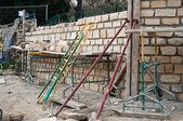 Ashlar wall site with scaffolding — Stock Photo