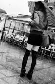 PARIS - France - 1 November 2013 - woman with mini skirt waiting with umbrella — Stock fotografie