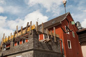 Construction site with scaffolds on private house — Stock Photo