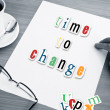 Concept office cup of coffee and word time to change on white page — Stock Photo #74007531
