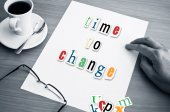 Concept office cup of coffee and word time to change on white page — Stock Photo