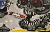 MULHOUSE - France - 08 June 2015 -  graffiti of skull with cigarette  during the BOZAR graffiti festival - quay of sinners in Mulhouse — Stock Photo