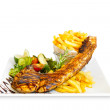 Pork ribs back with french fries and vegetable salad on the side. — Stock Photo #69654615