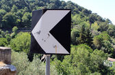 Road Sign and Shooting Bullet — Stockfoto