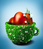 Easter eggs in grass cup with daisy flowers and snowdrops — Stock Photo