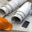 Blueprints, house model and construction equipment — Stock Photo #53442455