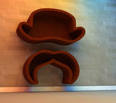 Bookshelf in shape of hat and mustache — Stock Photo