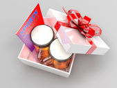 Gift box with beer mugs and sports magazine — Stock Photo