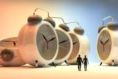 Tiny people and alarm clocks, time passing concept — 图库照片