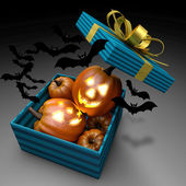 Pumpkins in present box. Halloween design. — Stock Photo