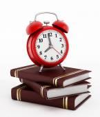 Red alarm clock on books — Stock Photo