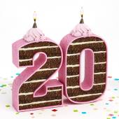 Number 20 shaped chocolate birthday cake with lit candle — Stock Photo