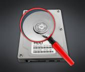 Magnifying glass on hard disk drive — Foto Stock