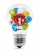 Colorful gears inside the light bulb — Stock Photo