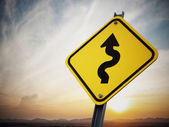 Curves ahead road sign — Stock Photo