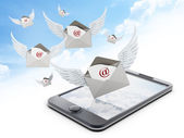 Mail enveloppe with wings on smartphone — Stock Photo