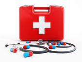 First aid kit, stethoscope and pills — Stock Photo