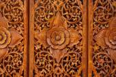 Pattern of flowers carved on wood — Stock Photo