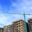 Construction site with cranes on blue sky background — Stock Photo #52218867